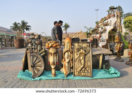 KOLKATA- FEBRUARY 23: Visitors deciding on sculptors and murals during the Handicraft Fair  on February 23, 2011 in Kolkata, India.