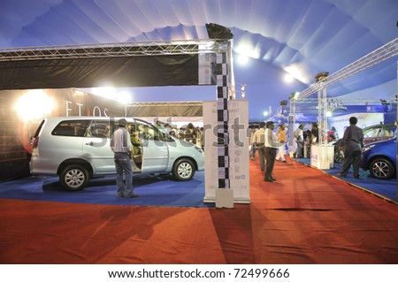 KOLKATA- FEBRUARY 20:  Visitors gathering around the car section of  the Information and Communication Technology (ICT) conference and exhibition in Kolkata, India on February 20, 2011.