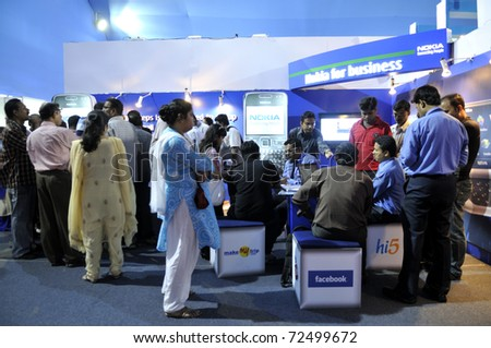 KOLKATA- FEBRUARY 20: Visitors gathering inside the booth of NOKIA , during the Information and Communication Technology (ICT) conference and exhibition in Kolkata, India on February 20, 2011. - stock photo