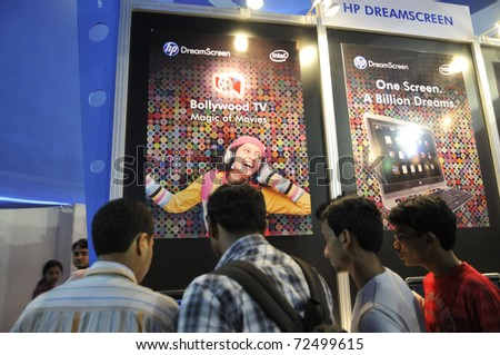 KOLKATA- FEBRUARY 20: Young adults checking a HP DreamScreen , during the Information and Communication Technology (ICT) conference and exhibition in Kolkata, India on February 20, 2011.