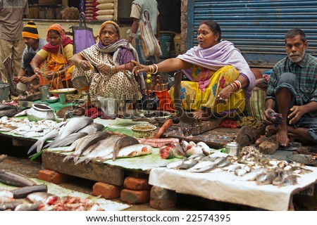 KOLKATA, INDIA - DECEMBER 18: Unknown people selling fish at a street market on December 18, 2008 in the Chowringhee area of Kolkata, West Bengal, India