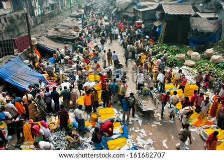 Kolkata, India - Feb 11: Top View Of Crowd Of Customers And Sellers Of Mullik Ghat Flower Market On February 11, 2013. The Market Is 125 Years Old. More Than 2000 Sellers Work In The Market Every Day