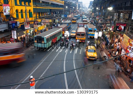 KOLKATA INDIA JAN 17 People and cars blurred in motion on the busy street of the asian metropolis on January 17 2013 in Kolkata India Kolkata has a density of 814.80 vehicles per km road length