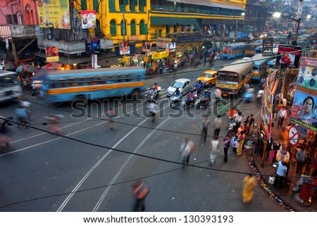 KOLKATA INDIA JAN 17 Street traffic blurred in motion at evening on January 17 2013 in Kolkata India Kolkata has a density of 814.80 vehicles per km road length