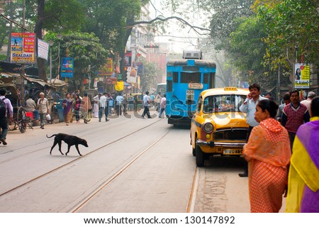 "KOLKATA, INDIA - JAN 20: Transport and human traffic on busy asian street on January 20, 2012. Kolkata's ""road space"" was only 6% compared to 23% in Delhi & 17% in Mumbai"