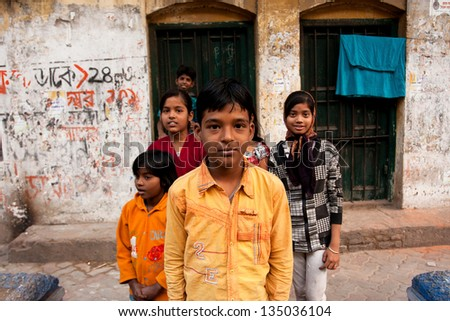 KOLKATA, INDIA - JAN 17: Unidentified children pose outdoor after school classes on January 17, 2012 in Kolkata, India. Kolkata's literacy rate of 87.14% exceeds the all-India average of 74%.
