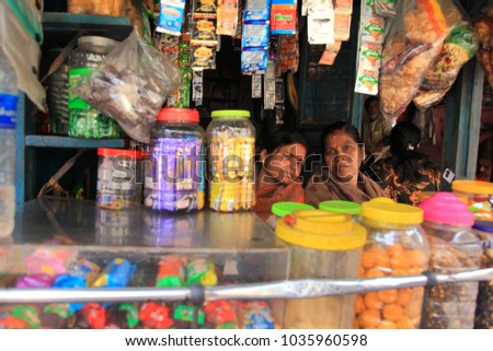 KOLKATA, INDIA -JAN 16 : Unidentified street vendor sits in his small shop in the busy streets of Kalighat on January 16, 2018 in Kolkata, West Bengal,India. #1035960598