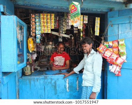 Kolkata, India - March 18, 2017: A shopkeeper selling items in his shop. #1017551947