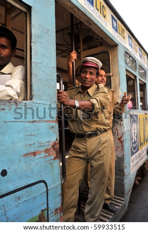 KOLKATA, INDIA - OCTOBER 27: Local people go by tram in Kolkata on October 27, 2009.  The Kolkata tram is the oldest operating electric tram of Asia, running since 1902.
