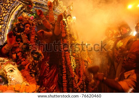 KOLKATA - OCTOBER 17: Devotees praying in-front of Durga idol before immersing in the river during Durga Puja festival on October 17, 2010 in Kolkata, India.