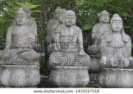 Kolkata, West Bengal/India - June 20, 2019: Little Buddhist monks sculpture all together with nature around at 'Japanese Garden' inside 'Eco Park', Newtown. #1433567318