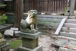 Komainu, guardian dog at the approach to the shrine