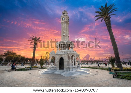 Konak Square street view with old clock tower (Saat Kulesi) at sunset. It was built in 1901 and accepted as the official symbol of Izmir City, Turkey.  Imagine de stoc ©