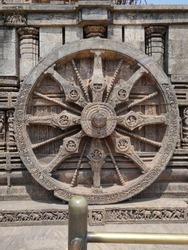 Konark Chakra,  a  monumental representation of the sun God Surya's chariot wheel.