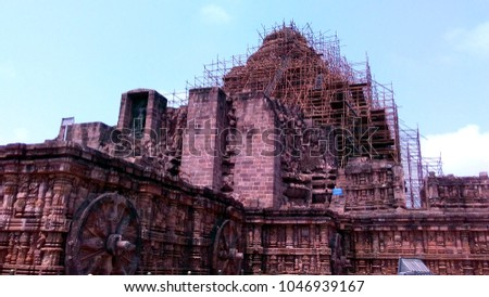 Konark Sun Temple UNESCO World heritage site damaged ancient building ruin supported by iron steel frames view with blue sky , copy space for text paste