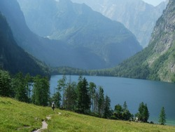 Konigsee. Bayern. Deutschland. Germany The long way to the beautiful Lake in the Mountain. Mountain road in the alps. Trekking in the alps in bavaria