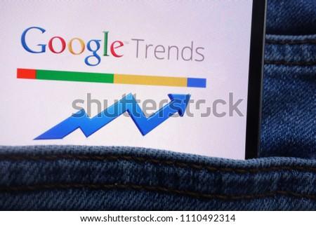 KONSKIE, POLAND - JUNE 11, 2018: Google Trends logo displayed on smartphone hidden in jeans pocket