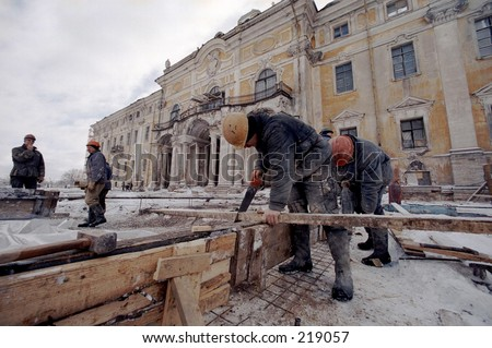 Konstantinovsky  palace - Vladimir Putin's president residence during reconstruction. The worker with a saw.