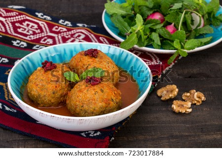 Koofteh Tabrizi Large Meatballs Stuffed With Dried Fruits And Nuts In Tomato Turmeric Broth A Traditional Azeri And Iranian Dish Served In Turquoise Bowl Garnished With Barberries