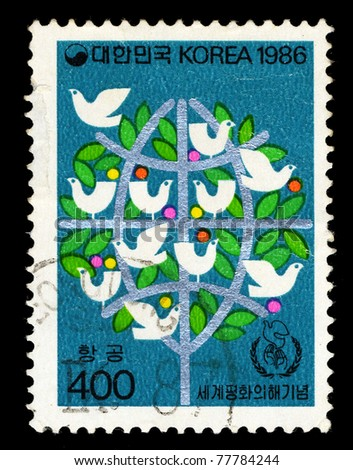 KOREA - CIRCA 1986: A stamp printed in Korea shows image of pigeon and tree, circa 1986.