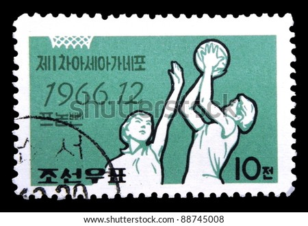 "KOREA - CIRCA 1966: stamp printed in the Korea Nord shows basketball with the inscription and name of a series ""Games of the New Emerging Forces (GANEFO)"", circa 1966"