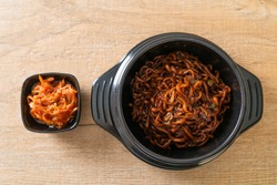 Korean black spaghetti or instant noodle with roasted chajung soybean sauce (chapagetti) - Korean food style