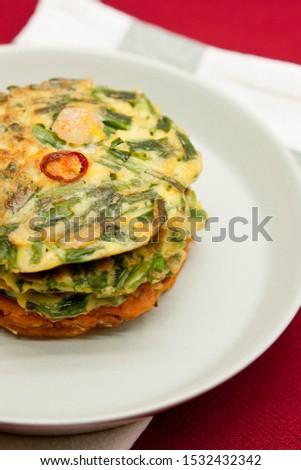Korean food, korean pancake (Pajeon and Kimchi-jeon) on red background.