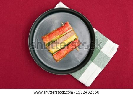 Korean food, korean pancake (Sanjeok) on red background.