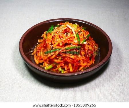 Korean food Musaengchae(Seasoned Julienned Korean Radish Salad) in a round bowl, South Korea Stock photo ©