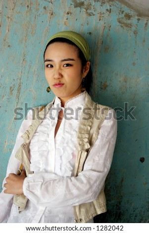 Korean girl looking unhappy - stock photo