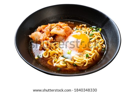 Korean instant noodles with kimchi and egg in isolated