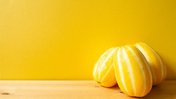 Korean oriental melon on wooden table. with yellow background