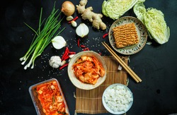 Korean pickle, Kimchi vegetable, traditional fermented vegetable for side dish and traditional korean, foods on black background.