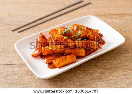 Korean rice cake stick with sausage in spicy sauce (Tteokbokki) - Korean food style