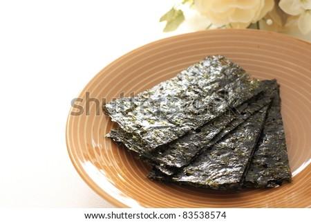 Korean seasoned dried laver on plate - stock photo