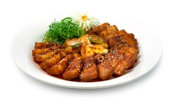 Korean Spicy Pork Bulgogi (Jeyuk Bokkeum) Korean Food Style with thin slice of pork belly and Kochujung Sauce Traditional Dish Decorate carved Leek and vegetable sideview