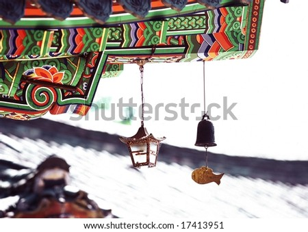 Korean Tradition and Symbol - artistic painted eaves of wooden architecture in Korea background with beautiful roof