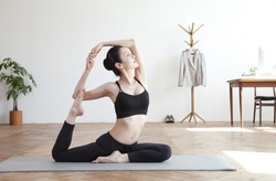 Korean woman doing yoga