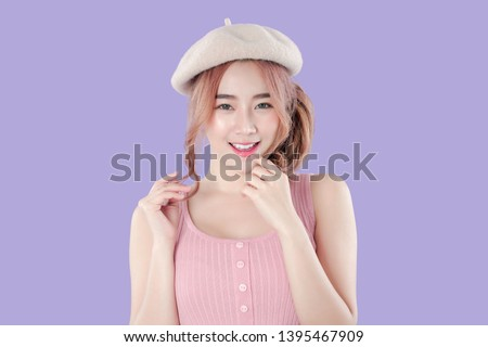 Korean woman relaxing poses and smile, tank top with beret hat, purple background