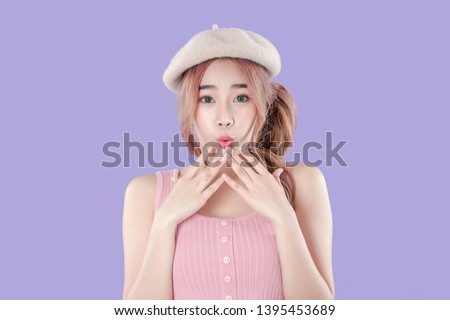 Korean woman shocking for special deals & discounts of promotions, tank top with beret hat, purple background