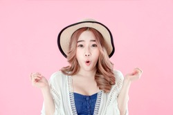 Korean woman tourist shocking for special deals & discounts of travel promotions, summer holiday clothing, pink background