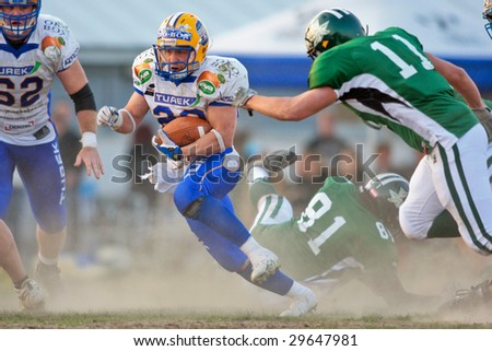KORNEUBURG, AUSTRIA - MAY 3: RB Mario Nerad (#20, Giants) in action as his team beat the Danube Dragons at Austrian Football League 16:34 on May 3, 2009 in Korneuburg.