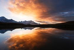 Koruldi - mountain lake in Svaneti, Georgia. Mirror reflection in water. Landscape with beautiful dawn