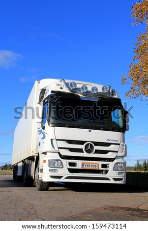 KOSKI FINLAND OCTOBER 20 White Mercedes-Benz Actros truck with trailer parked on October 20 2013 in Koski Finland Mercedes-Benz Actros wins Ireland's first Truck of the Decade award