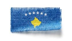 Kosovo flag on a piece of cloth on a white background