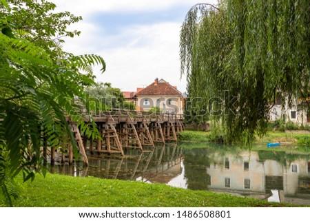Kostanjevica na Krki, the wooden bridge on the river Krki at the entrance of the village Stock photo ©