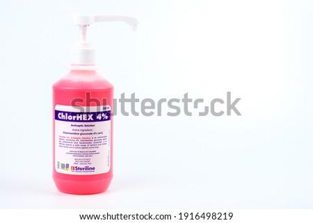 Kota Bharu, Kelantan - February 14, 2021: ChlorHEX of antiseptic solution Hand Sanitizer in plastic bottle isolated on white background.