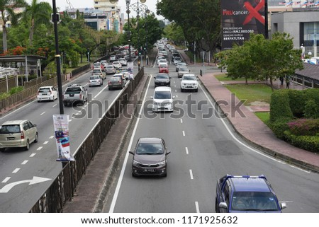 KOTA KINABALU,SABAH-Aug 31,2018 : View of Kota Kinabalu shop, street and traffic.Kota Kinabalu formerly known as Jesselton, is the capital of the state of Sabah, Malaysia.Underexpose and blurry #1171925632