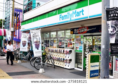 KOTO, TOKYO - JUNE 4, 2014: FamilyMart (one word) is the third largest convenience store chain in Japan. The company are in competition with their rivals, Seven Eleven (7 & I Holdings) and Lawson.