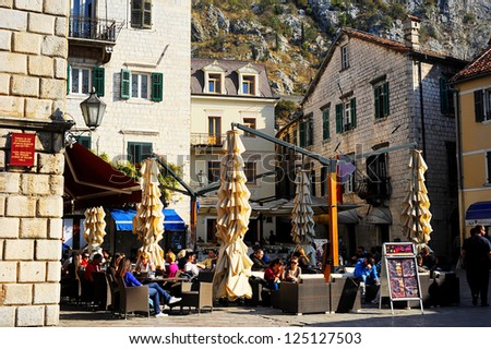 KOTOR, MONTENEGRO - NOVEMBER 3: Street cafe on  November 3, 2011 in Kotor old town. Kotor has one of the best preserved medieval old towns in the Adriatic and is a UNESCO world heritage site.